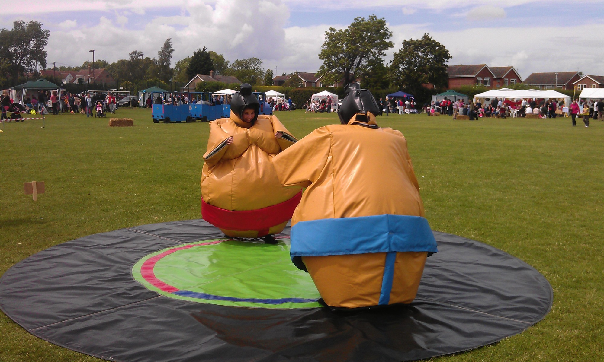 Two people in Sumo Wrestler costumes