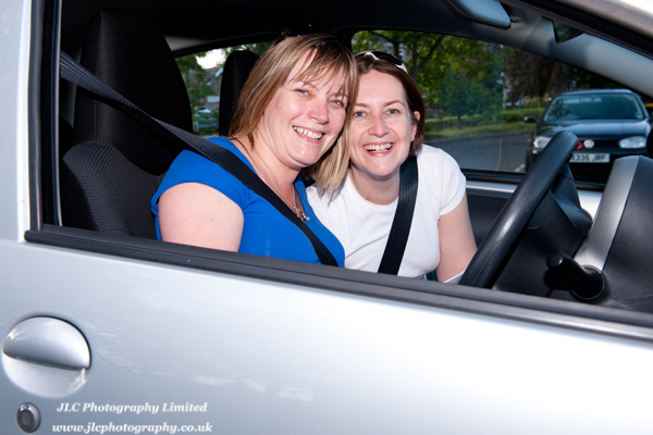 Two women sitting in a car after taking part in Somersham Carnival 2011 Car Treasure Hunt