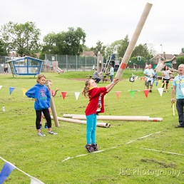 A young girl tossing the caber at a highland games