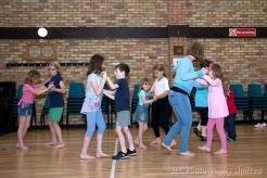 Children learning to ballroom dance.