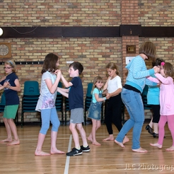Children learning to ballroom dance.