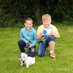 Two boys with a small dog