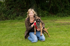 Woman with rosette-winning dog at the Somersham Novelty Dog Show 2014