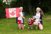 Two girls with a dog in fancy dress at the Somersham carnival Novelty Dog Show 2014.