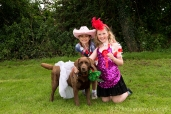 Two girls and a dog in fancy dress at Somersham Carnival 2014 Novelty Dog Show.
