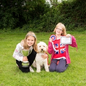Two young girls with dog, named best in show, at somersham carnival 2014.